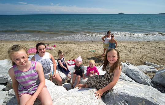 The O'Leary family from Blarney, Co Cork on Garryvoe Beach yesterday, which was closed because of effluent in the water