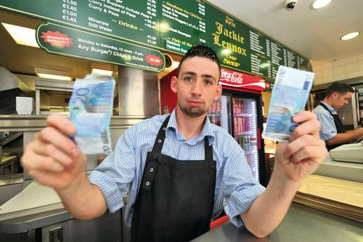 Lee Mc Carthy in Lennox's Chipper, Cork with the forged €20 notes Picture: Michael Mac Sweeney/Provision