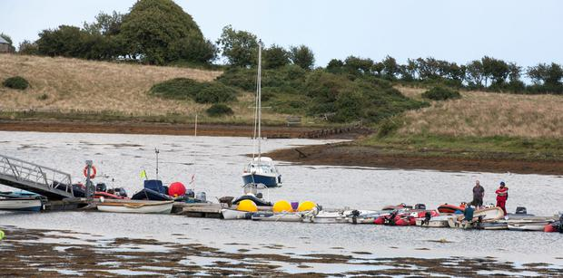 Small boats moored on a pontoon at the East Down Yacht Club, Killyleagh, Northern Ireland. Photo: PA