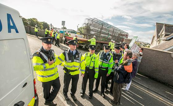 Gardai block off the road at Green's Bridge in Kilkenny, where protesters gathered close to the entrance to the site of the new bridge