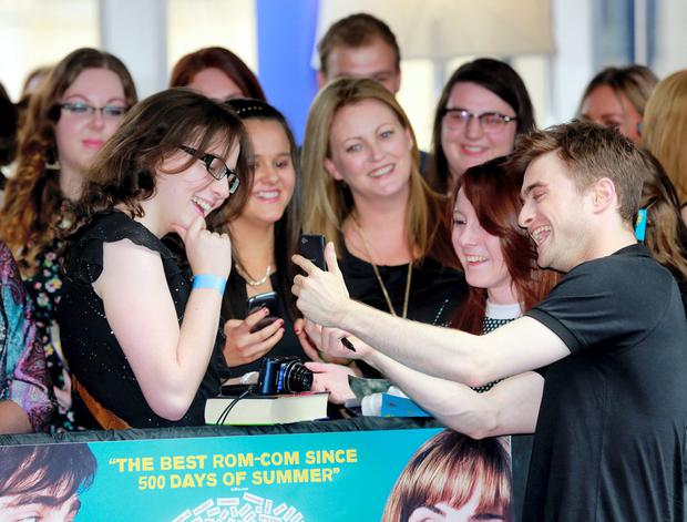 Daniel Radcliffe poses and signs autographs with fans at the Irish premiere of his new film What If at Cineworld in Dublin. Photo: Arthur Carron