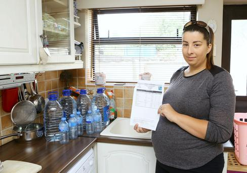 Sarah Heaney from Hogan Avenue Kileely pictured with her letter from Limerick City and County Council with the results from a drinking water test.