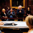 Members of the public file past the remains of former Taoiseach Albert Reynolds lying in repose in the Oak Room, Mansion House, Dublin yesterday