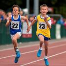 David McDonnell, Strokestown, Co.Roscommon, right, and Sean Hickey, Ballyduff, Co.Waterford, in action during the semi Final of the Boys U.12 100metres . HSE Community Games August Festival 2014, Athlone Institute of Technology, Athlone, Co. Westmeath. Picture credit: David Maher / SPORTSFILE