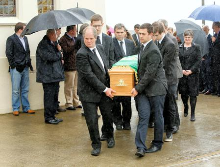 Mourners carry the coffin of former Limerick FG councillor Mary Harty who died of motor neuron disease.