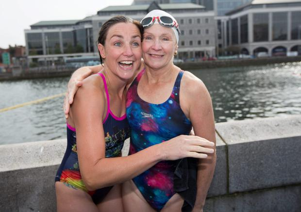 Rachel Lee, winner of the women's 95th Dublin Liffey swim, with her mother, Marian Lee, after the race. Photo: Fergal Phillips.