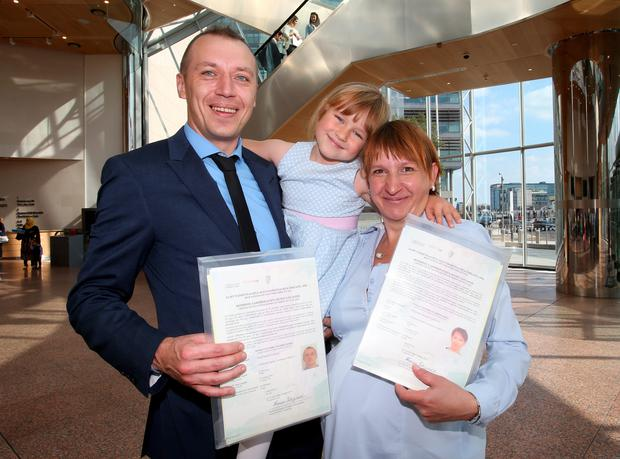 New Irish citizens pictured David and Margaret Woloszyk from Tyrrellstown [originally from Gdansk, Poland] pictured with their daughter Olivia [6] after the citizenship ceremony at the Dublin Convention Centre.