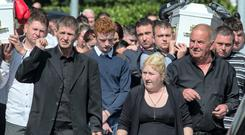 Parents Thomas and Helen O'Driscoll at their twin sons Thomas and Paddy funeral mass in Charleville (Photo:Mark Condren)