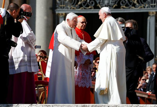 Pope Francis (right) greets meritus Pope Benedict XVI before a mass in Saint Peter's Square at the Vatican. The mass was only Benedict's third appearance at a public event since he resigned in February 2013.