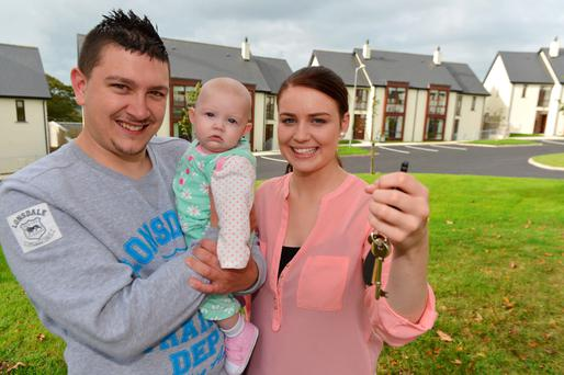 Shane Hickey, Caoilfhinn O'Driscoll with their daughter Keise who are the first recipients of a house in The Tannery estate, Bandon , Co. Cork. Photo: Provision