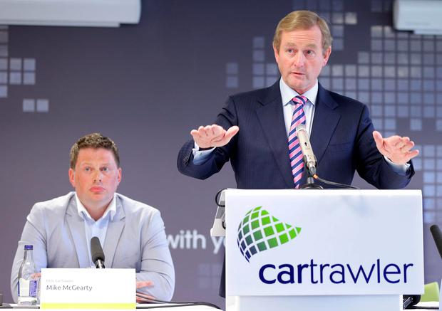 s Pictured are Mike McGearty, CarTrawler CEO and Taoiseach, Enda Kenny TD as CarTrawler, announces jobs Pic: Marc O'Sullivan