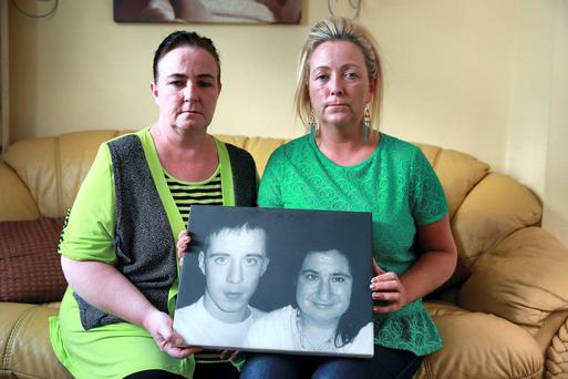 Deborah and Donna Lambe with a picture of their sister Linda and her son Danny Talbot who died while in Care. Picture: Arthur Carron