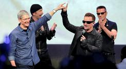 Tim Cook, Bono and the rest of U2 at the launch of the iPhone 6