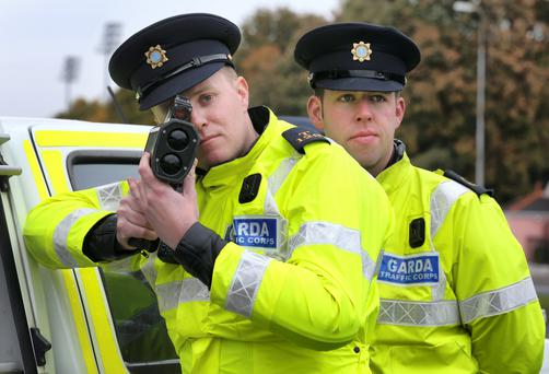 Garda Chris St Ledger and Gda John Cahalin from the National Traffic Bureau pictured operating a speed checkpoint on the Stillorgan Dual Carriageway ahead of The Garda Siochana and the Road Safety Authority RSA National Slow Down day. Photo: Frank McGrath