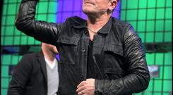 Bono throws a paper plane back at the audience at the Web Summit at the RDS in Dublin yesterday. Photo: Steve Humphreys