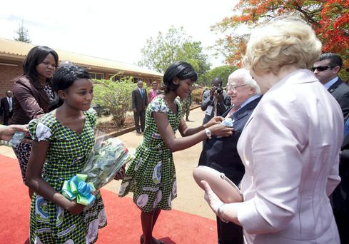 President Michael D Higgins and his wife Sabina arriving at the Lilongwe University of Agriculture and Natural Resources in Malawi yesterday. Photo: Chris Bellew/Fennells