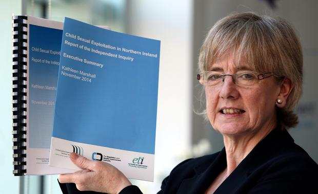 Former Scottish commissioner for children and young people Professor Kathleen Marshall holds her report on child sexual exploitation in Northern Ireland in her office in Belfast