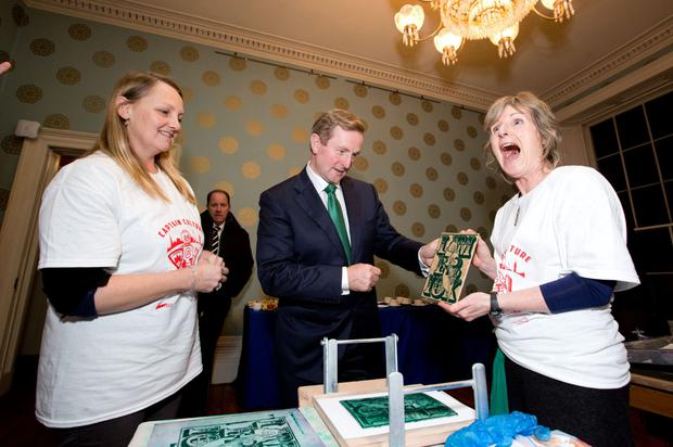 Enda Kenny meets Suzannah O'Reilly and Dee Gallagher of the Limerick Print makers who gave the Taoiseach a hands on demonstration of screen and lino printing at Culture House yesterday. Photo: Sean Curtin