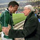Brian O'Driscoll celebrates with Jack Kyle in 2009. Both men make the side.