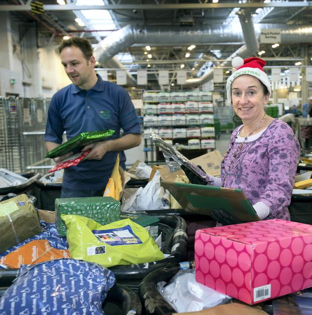 Jason Cavanagh and Deborah O'Loughlin sort out christmas mail at the Central Mail Depot in Park West, Dublin.