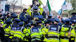 Gardai during the protests in Dublin yesterday. Photo Collins