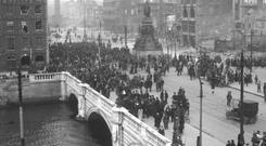 Destruction Citizens gather around O'Connell Street after the 1916 Rising. Photo: NPA/Independent collection.