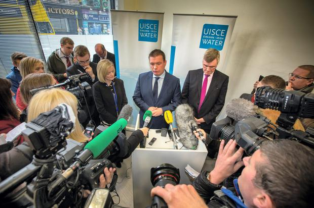 Environment Minister Alan Kelly with Irish Water chief John Tierney face the media