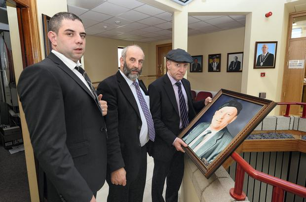 Kerry councillors Johnny, Danny and Michael Healy-Rae with a picture of their father in council chambers last night. Photo: Domnick Walsh.