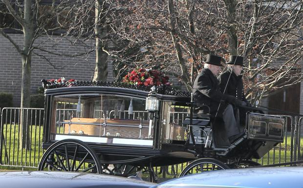 The horse-drawn hearse carries the remains of teenage road-crash victim Dayne Cody from his funeral Mass at St Matthew's Church in Dublin