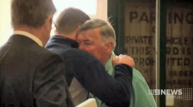 Barry Lyttle hugs his father