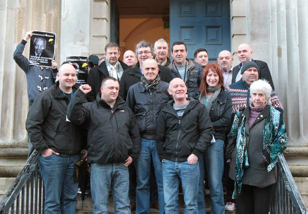 Derry Independent councillor Gary Donnelly (front second from left) and friends Terry Porter and Liam Brogan (both centre) leaving Derry Court yesterday. Also Included are TDs Eamon O Cuiv, Tom Pringle, Clare Daly and Maureen O'Sullivan. Photo: Margaret McLaughlin