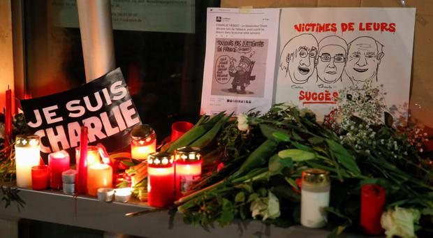 Candles and a placard which reads