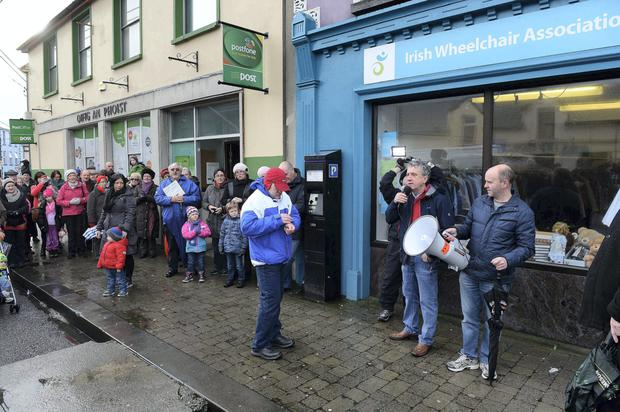 Locals in Listowel, Co Kerry, protest against plans to close their stand-alone post office.