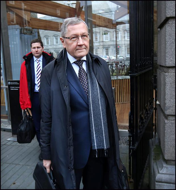 Klaus Regling leaving the Oireachtas Banking Inquiry, alongside Conor Sweeney from the European Stability Mechanism