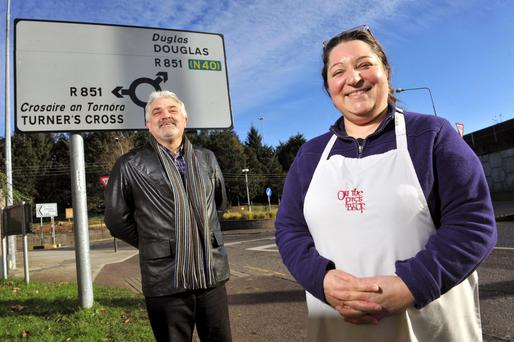 Cllr. Joe Harris and Isabelle Sheridan of On the Pig's Back pictured on the Cork County/City Boundary (roundabout) in Douglas, Cork. Pic Daragh Mc Sweeney/Provision
