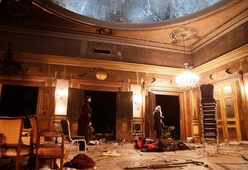 Destruction: Damage inside the 'Nadi al-Sharq', an event venue in Damascus, following rocket attacks last week by Islam Army insurgents in Syria