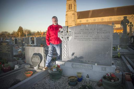 Pat Buckley at the grave of his brothers Mark (30) and James (22) at the Holy Rosary Cemetery, Midleton, Co Cork. Photo: Pic Michael Mac Sweeney