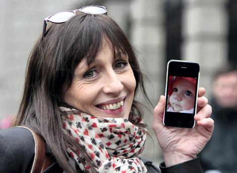 Jennifer Kehoe of Naas, Co Kildare, of the One Day More support group outside Leinster House yesterday. Photo: Tom Burke