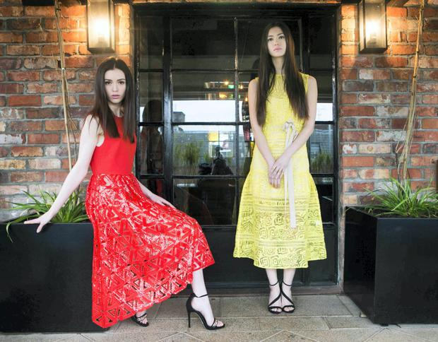 Pictured today at the BT2 Press Day were (l to r) models Louise (Self Portrait Sequin Dress €340) and Li Ann (Yellow Self Portrait Burnout Midi Dress €305) Picture: Leon Farrell / Photocall Irelan