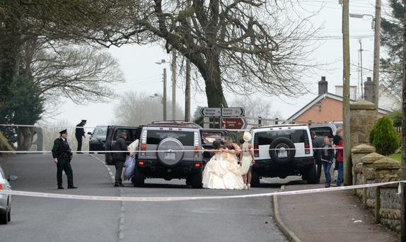 Members of the wedding party leave the church after the shooting. Photo: Ronan McGrade