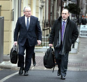 Tony O'Brien, left, director general of the HSE, and Ray Mitchell, assistant national director of parliamentary affairs HSE, arriving for the meeting of the Oireachtas Committee on Health and Chidren at Leinster House yesterday. Photo: Tom Burke