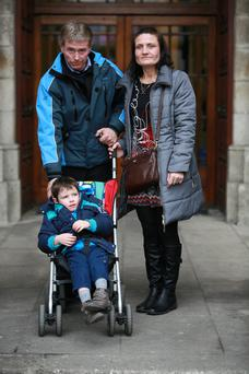 Kevin Dunphy-English with his parents, Jane Dunphy and Seamus English, of Mooncoin, Co Kilkenny, after receiving a €2m interim payout in settlement of a personal injuries case.