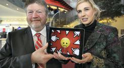 Minister for Children James Reilly with PhD student Sinead Kane, from Youghal, at the Helix in DCU before the launch yesterday of 'Understanding Cyberbullying, a guide for Parents and Teachers' by Prof Mona O'Moore. Photo: Frank McGrath