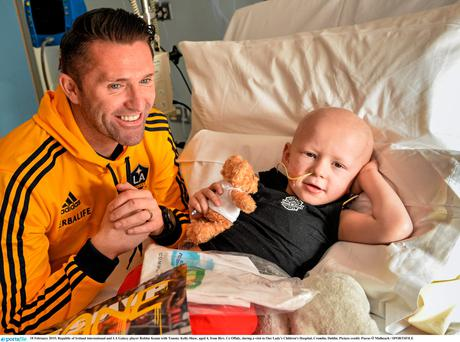 Robbie Keane with Tommy Kelly-Shaw, aged 4, from Birr, Co Offaly, during a visit to Our Lady's Children's Hospital, Crumlin, Dublin
