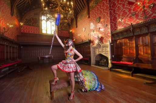 Ellie O'Hanrahan, student of Blackwater Community School, Lismore, wearing the Junk Kouture entry in the banquet Hall of Lismore Castle. Her student group have used Irish Independent Newspapers as the main material in the garment (titled 'Independence') so
