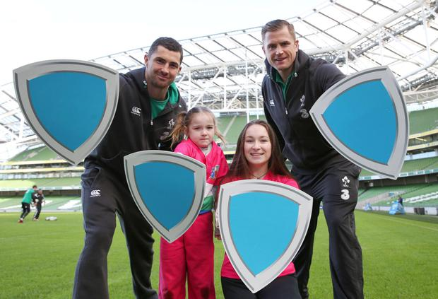 Rob Kearney and Jamie Heaslip with Caoilfhinn Egan (6) and Alannah Egan (15) from Suttonians as they joined the ISPCC to 'Stand Up Against Bullying' at the launch of the organisation's 'Shield Your Club' initiative at the Aviva Stadium yesterday. Photo: Bi