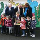 Junior Minister Ged Nash, Taoiseach Enda Kenny, Tánaiste Joan Bruton and Jobs Minister Richard Bruton with Oscar Power (4), Isabelle Heapes (4), Amelia Wetten (3), Ruben Corrigan (4) and Kiya O'Connor (4) at the launch of the Low Pay Commission