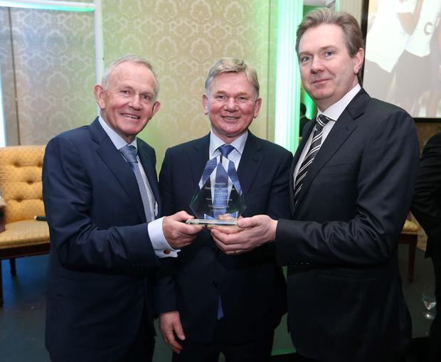 Ciaran Fitzgerald, centre, is presented with the Outstanding Contribution to Irish Rugby Award by Leslie Buckley, founder of Haven, and Stephen Rae, Editor in Chief of INM, at the Haven Six Nations rugby lunch 2015 at the Shelbourne Hotel, Dublin. Photo: Damien Eagers
