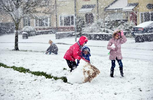 Children have fun after Heavy snow showers fell in Tuam, County Galway. Photo: Ray Ryan