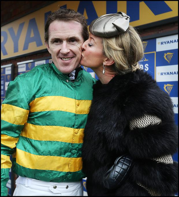 Tony McCoy is kissed by his wife Chanelle. Photo: Steve Humphreys